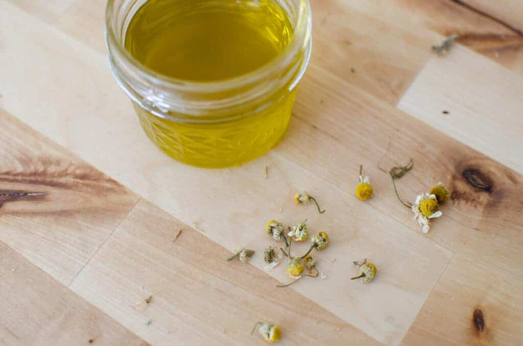 How to Make Herbal Infused Oil for Salves and Skincare | chamomile infused oil